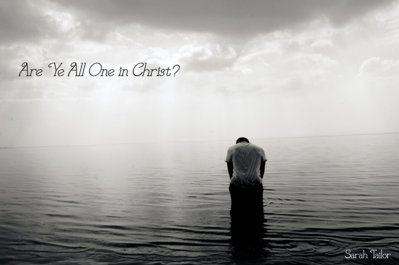 man sad, alone, in water with gray skies overhead